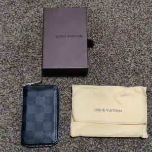 Louis Vuitton damier graphite zippy wallet.